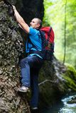 Man climbing mountain wall Royalty Free Stock Photography