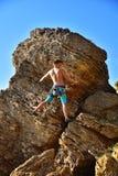 Man climbing on Mountain Stock Photos
