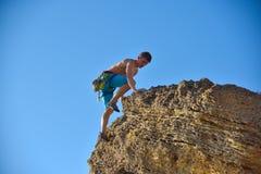 Man climbing on Mountain Stock Image