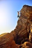 Man climbing on Mountain Royalty Free Stock Photography