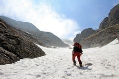 Man climbing mountains Stock Photography