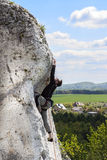 Man climbing natural difficult wall. Stock Photography