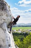 Man climbing natural rocky wall in Poland. Royalty Free Stock Photography