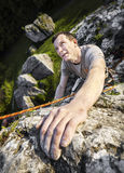 Man climbing natural rocky wall. Stock Images