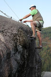 Man climbing rock. On natural park Royalty Free Stock Images