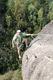 Man climbing rock Stock Photo