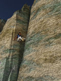 Man climbing rock chimney Royalty Free Stock Images