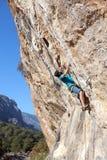 Man climbing on Rock exercising Strength Courage Agility Stock Photo