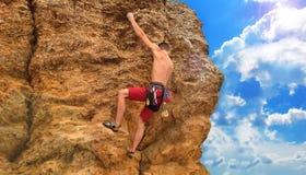 Man climbing on rock Stock Photography