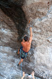 Man climbing on the rock route summer Stock Images