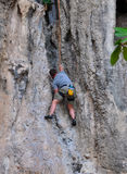 Man climbing on the rock route summer Royalty Free Stock Image