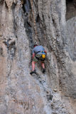 Man climbing on the rock route summer Royalty Free Stock Images