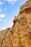Man climbing on rock Stock Image