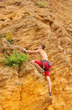 Man climbing on rock Royalty Free Stock Photo