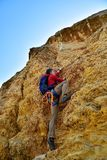 Man climbing on rock Stock Photo