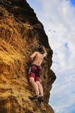 Man climbing on rock Royalty Free Stock Image
