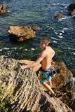Man climbing on a rock Stock Photo