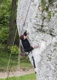 Man climbing rocky wall. Stock Photography