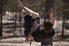 Man climbing on rope Stock Photography