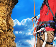 Man climbing. A rope on a rock Royalty Free Stock Images