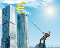 Man climbing skyscraper with euro sign Stock Photography