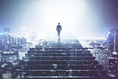Man climbing stairs. Back view of businessman climbing stairs on abstract night city background. Growth concept. Double exposure Royalty Free Stock Images
