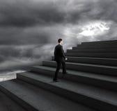 Man climbing stairs Stock Photos