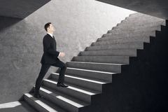 Man climbing stairs royalty free stock images