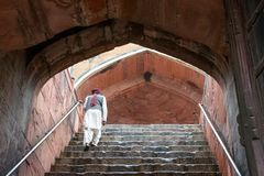 Man climbing stairs of Humayun`s Tomb, in Delhi, India. stock images