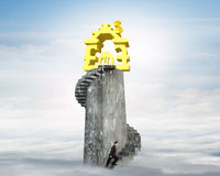 Man climbing stairs to money house on tower Royalty Free Stock Photo