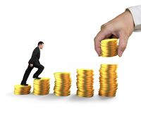 Man climbing step stairs of golden coins stacked by hand Royalty Free Stock Photo