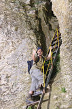 Man climbing to cave Royalty Free Stock Photo