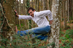Man climbing on a tree Royalty Free Stock Image