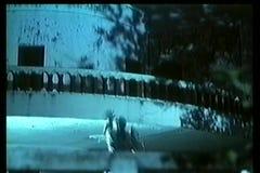 Man climbing up balcony stock video footage