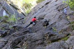 Man is climbing up Stock Image