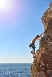 Man climbing up on mountain Royalty Free Stock Image