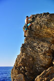 Man climbing up on mountain Royalty Free Stock Photo