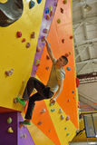 Man Climbing Up On Practice Wall Stock Images