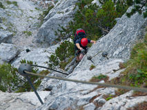 Man climbing on via ferrata Royalty Free Stock Image