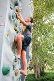 Man climbing a wall Royalty Free Stock Photography