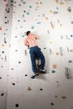 Man at the climbing wall Stock Photography