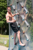 Man on climbing wall Stock Photos