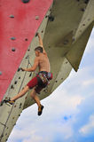 Man climbing on wall Royalty Free Stock Image