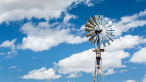 Man climbing a windmill Royalty Free Stock Images