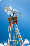 Man climbing a windmill Royalty Free Stock Photography