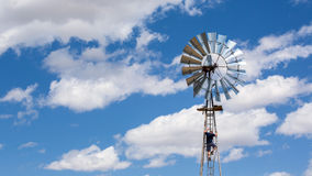 Man climbing a windmill Stock Photo