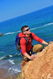 Man climbs on a cliff Stock Image
