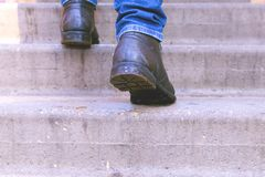 Man climbs the concrete stairs royalty free stock photo