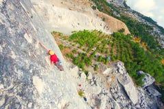 A man climbs the rock. Stock Image