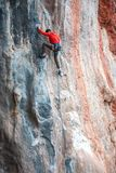 A man climbs the rock. Climbing in nature. Fitness outdoors. Active lifestyle. Extreme sports. The athlete trains on a natural relief Stock Photo